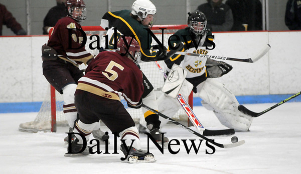 Reading: Newburyport's Gaven LaValley (5) takes a shot which would find the back of the net during the first period of Saturday night's game against North Reading. The Clippers won 8-3. Photo by Ben Laing/Staff Photo