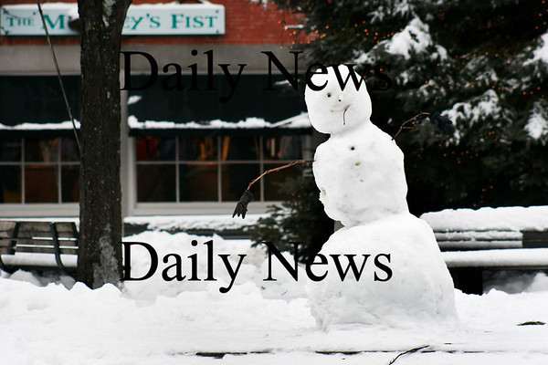 Newburyport: A snowman stands in Market Square in downtown Newburyport Wednesday afternoon, created from the most recent snow fall Tuesday night. Photo by Ben Laing/Staff Photo