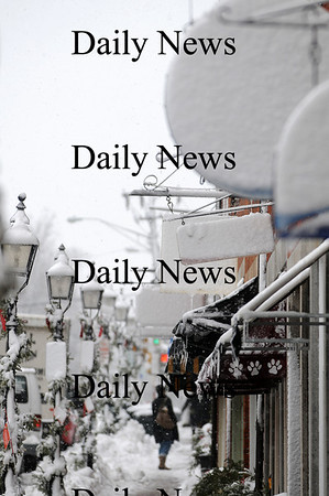 Newburyport: Signs along State Street in Newburyport are obscured by Monday's snowfall. Photo by Ben Laing/Staff Photo