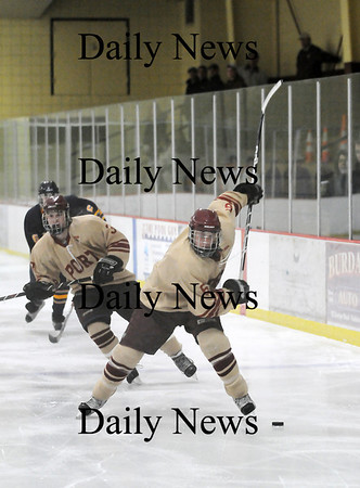 Newburyport: Connor Wile (6) of Newburyport winds up for a slapshot during Monday's 3-0 victory over Lynnfield. Photo by Ben Laing/Staff Photo