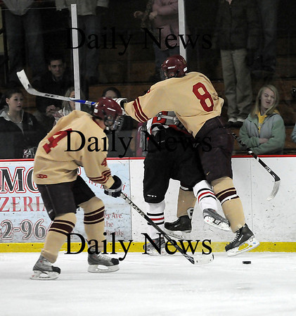 Newburyport: Newburyport's Derek Freeman (8) knocks an Amesbury player into the boards during Wednesday night's 3-1 victory over the Indians. Photo by Ben Laing/Staff Photo