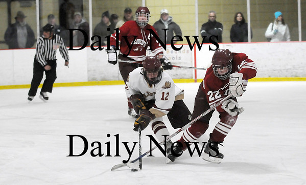Newburyport: Newburyport's David Cusack (12) picks the pocket of Gloucester's John Interrante (22) during Monday afternoon's game at the Graf Rink. Photo by Ben Laing/Staff Photo