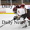 Newburyport: Newburyport's Cam Roy (4) races up the ice alongside Gloucester's John Interrante (22) during Monday's game at the Graf Rink. Photo by Ben Laing/Staff Photo