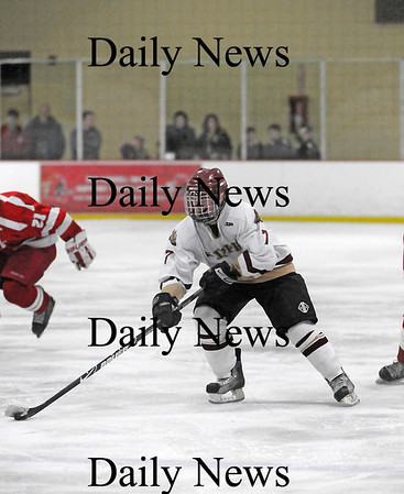 Newburyport: Newburyport's Gaven LaValley (7) carries the puck up the ice for the Clippers as they took down Masconomet 2-1 on Saturday night. Photo by Ben Laing/Staff Photo