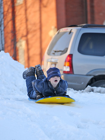 Newburyport: Seth Hanson, 7, of Newburyport, prepares to sled down one of the hills at the Mall in Newburyport Wednesday afternoon. Photo by Ben Laing/Staff Photo