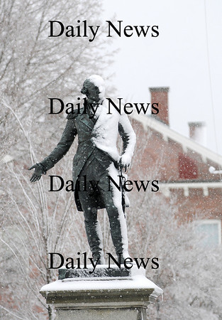 Newburyport: The statue of George Washington, which stands at the intersection of Pond and High Streets, is half covered with snow from Monday's storm. Photo by Ben Laing/Staff Photo