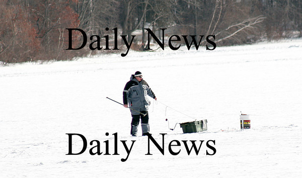Newburyport: An ice-fisherman picks out a spot on the ice at the Artichoke Resivior in Newburyport Monday afternoon. Photo by Ben Laing/Staff Photo