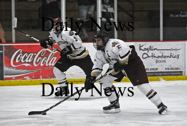Newburyport: Newburyport's Billy Boudreau (2) skates the puck up the ice, flanked by teammate Kyle McElroy (3) during Saturday's 2-1 win over Masconomet. Photo by Ben Laing/Staff Photo