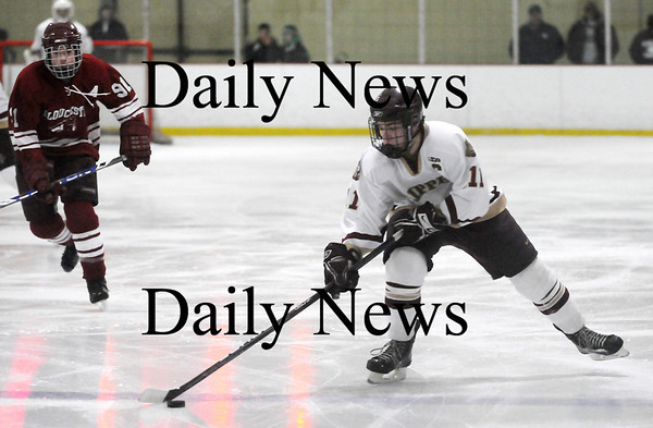 Newburyport: Ryan Cutter (11) of Newburyport skates the puck up the ice during Monday's game against Gloucester. Photo by Ben Laing/Staff Photo