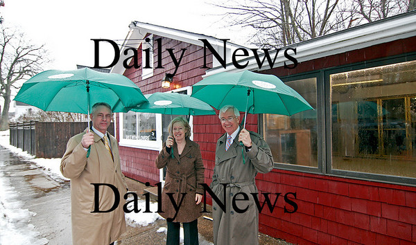 Amesbury: Mayor Thatcher Kezer, left, director of the Pettingill House in Salisbury, Deb Smith, center, and President of the Provident Bank Charlie Cullen, right, stand outside the former site of Tracey's Flower Shop on Lionsmouth Road in Amesbury. The Provident Bank has donated the property to the Pettingill House. Photo by Ben Laing/Staff Photo
