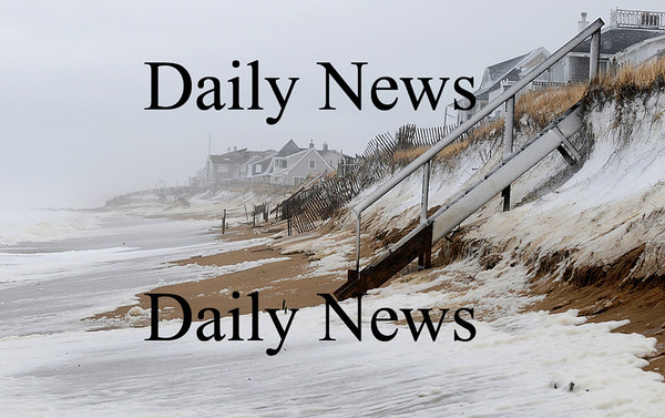 Newbury: Monday's high tide reached up the dunes along Plum Island, soaking the bottom few steps of this walkway. Photo by Ben Laing/Staff Photo