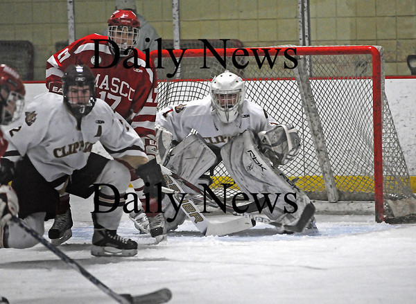 Newburyport: Newburyport goalie Anthony Federico keeps his eyes glued to the puck as teammate Billy Boudreau (2) prepares to help block the shot from a Masconomet opponent during Saturday's 2-1 Clipper victory. Photo by Ben Laing/Staff Photo