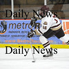 Newburyport: Newburyport's Dominic Ferreira (16) fires a shot from his defensman's position during Monday's game against Gloucester at the Graf Rink. Photo by Ben Laing/Staff Photo
