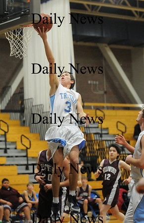 Byfield: Triton's Tom Bashaw (3) glides towards the hoop durng Wednesday nights 83-25 victory over Fellowship Christian in Byfield. Photo by Ben Laing/Staff Photo