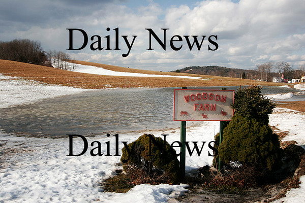 Amesbury: With the recent warm temperatures melting the snow, and the heavy rains that fell Monday, a small pond formed at the bottom of the hill at Woodsom Farm in Amesbury. Photo by Ben Laing/Staff Photo