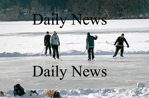 Newburyport: A group of young men play pond hockey on a fresh sheet of ice at the Artichoke Resivior Wednesday afternoon. Photo by Ben Laing/Staff Photo