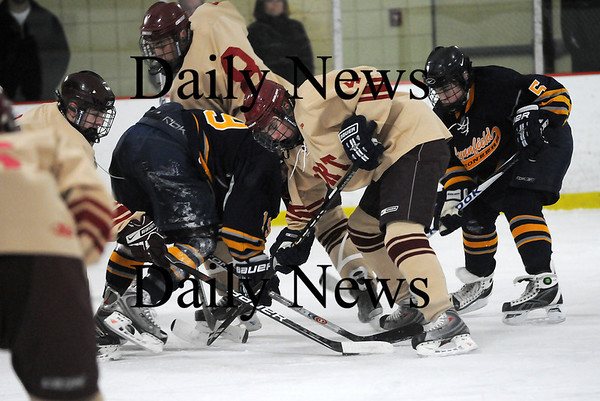 Newburyport: Newburyport's Cameron Roy (4) battles for a face-off during Monday afternoon's 3-0 victory over Lynnfield. Photo by Ben Laing/Staff Photo