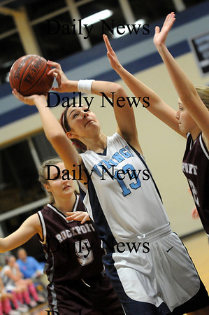 Byfield: Triton captain Maxine Crossman (13) puts up a shot against Rockport Tuesday night in Byfield. Photo by Ben Laing/Staff Photo