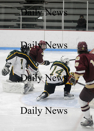 Reading: Newburyport's Gaven LaValley (5) pokes the puck past the North Reading goalie for his second goal of the night as the Clippers defeated the Hornets, 8-3 Saturday night. Photo by Ben Laing/Staff Photo
