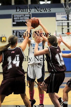 Byfield: Triton's Jen Rock (32) puts up a shot with two Rockport defenders in her face as the two teams battled Tuesday night in Byfield. Photo by Ben Laing/Staff Photo