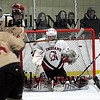 Newburyport: Conor Wile (6) of Newburyport puts the puck past Amesbury goalie Matt Irwin (30) during Wednesday night's 3-1 victory over the Indians. Photo by Ben Laing/Staff Photo