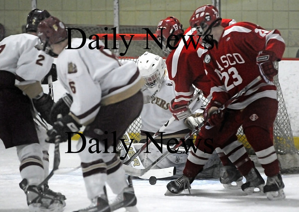 Newburyport: Newburyport's goalie Anthony Federico stays focused on the loose puck in front of him despite the crowd of teammates and Masconomet opponents. The Clippers took down the Chieftans 2-1 on Saturday night. Photo by Ben Laing/Staff Photo