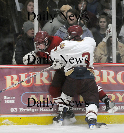 Newburyport: The Clipper's Kyle McElroy (3) checks a Gloucester Fisherman into the boards during Monday's game at the Graf Rink. Photo by Ben Laing/Staff Photo