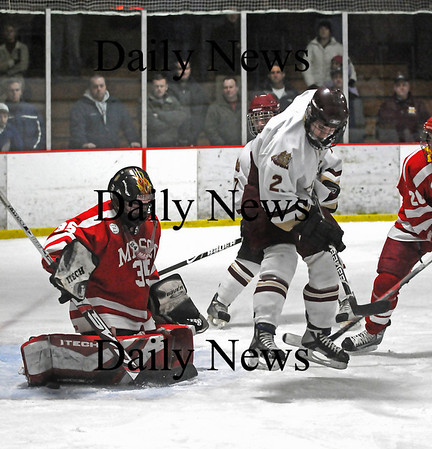 Newburyport: Clipper Billy Boudreau (2) leaves his skates while he screens Masconomet goalie Casey Tudor (35) on a shot during Saturday's 2-1 win. Photo by Ben Laing/Staff Photo