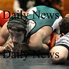 West Newbury: The referee gets down low to watch as Pentucket's Ben Meuse attempts to pin his opponent from Everett during Wednesday's match in West Newbury. Photo by Ben Laing/Staff Photo