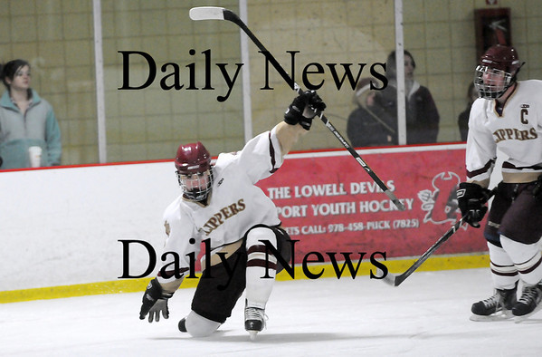 Newburyport: Newburyport's Gavin LaValley (7) celebrates after scoring the opening goal in Monday afternoon's game against Gloucester at the Graf Rink. Photo by Ben Laing/Staff Photo