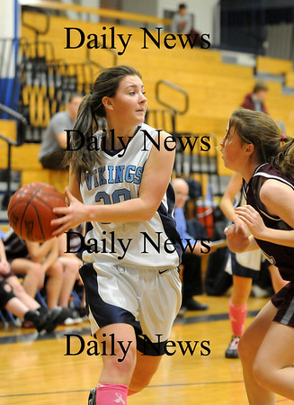 Byfield: Trtion's Jessica Canning (30) looks for an open teammate during Tuesday night's game against Rockport in Byfield. Photo by Ben Laing/Staff Photo