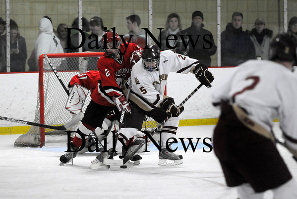 Newburyport: Newburyport's Ben Bransfield (25) tries to tip in a pass from teammate Billy Boudreau (2) during Wednesday night's 5-0 win over Amesbury. Photo by Ben Laing/Staff Photo