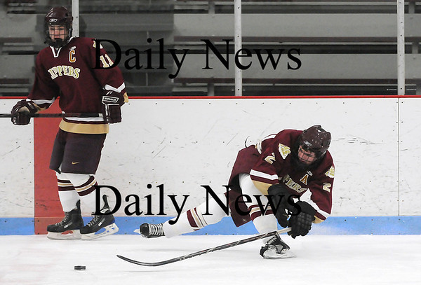 Reading: Newburyport's Billy Boudreau (2) gets tripped up during Saturday night's 8-3 win over North Reading. Photo by Ben Laing/Staff Photo