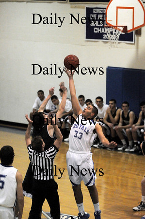 Georgetown: Julio Colon (33) of Georgetown, outleaps Pentuckets Brandon Lozier (31) for the opening tip at Tuesday nights game. Photo by Ben Laing/Staff Photo