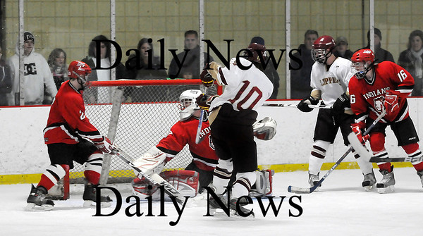 Newburyport: Newburyport's Sean Hickman (10) puts the puck past Amesbury's Matt Irwin (30) for one of the Clippers' 5 goals in their shutout win over the Indians. Photo by Ben Laing/Staff Photo