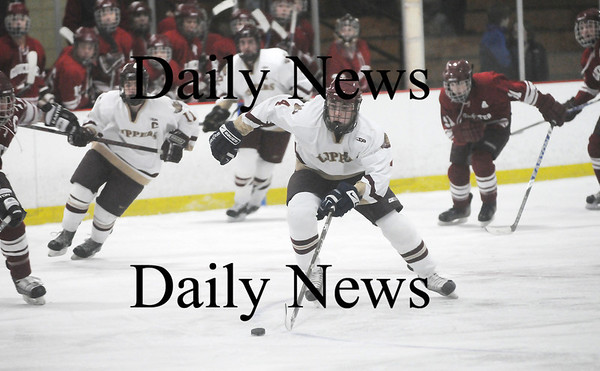 Newburyport: Newburyport's Cam Roy (4) takes the puck up the ice on a breakaway during Monday's game against Gloucester. Photo by Ben Laing/Staff Photo