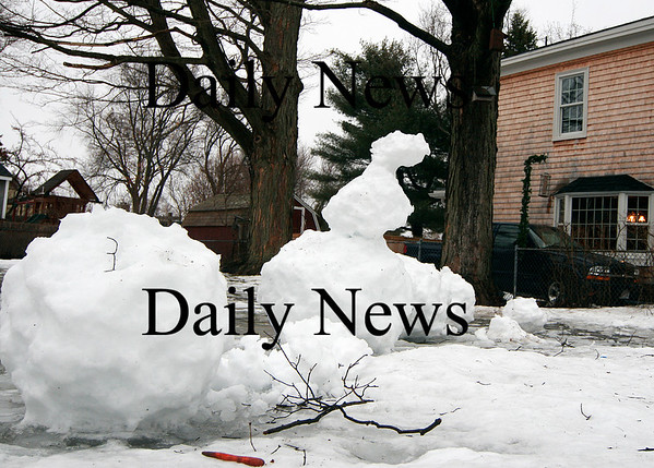 Newburyport: A trio of snowmen on Marlboro Street in Newburyport are a little worse for wear after Monday's rain storm and high temperatures melted most of them. Photo by Ben Laing/Staff Photo