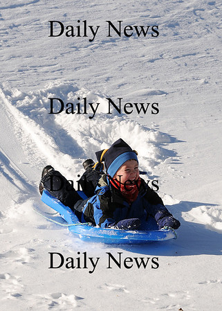 Amesbury: Teddy Batmaca, 4, of Amesbury, slides down a small hill at the Amesbury Town Park Wednesday morning. Photo by Ben Laing/Staff Photo