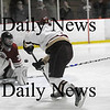 Newburyport: The Clipper's Cam Roy (4) fires a shot on Gloucester goalie Jason Brooks (31) during Monday's game at the Graf Rink. Photo by Ben Laing/Staff Photo