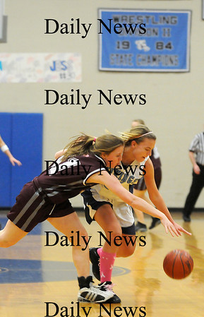 Byfield: Triton's Jen Rock (32) steals the ball from Rockport's Alex Paradis (11) during Tuesday night's game in Byfield. Photo by Ben Laing/Staff Photo
