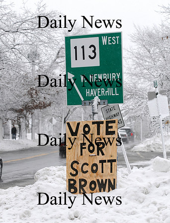 Newburyport: A home made sign urging passerby's to vote for Scott Brown stands at the Three Roads intersection in Newburyport Monday afternoon. Brown is running for United States Senate, and is facing Attorney General Martha Coakley in Tuesday's election. Photo by Ben Laing/Staff Photo