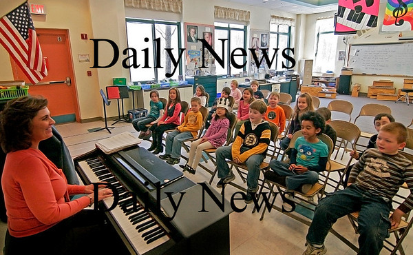 Newbury: Students in Kelly Williamson's first grade class warm up their vocal chords at the start of Laurie Peterson's music class at Newbury Elementary on Tuesday. Photo by Ben Laing/Staff Photo
