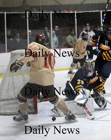 Newburyport: Newburyport's Sean Hickman (10) has his scoring oppurtunity ruined by the skate of Lynnfield goalie Craig Cataldo during the second period of Monday's 3-0 Clipper victory. Photo by Ben Laing/Staff Photo