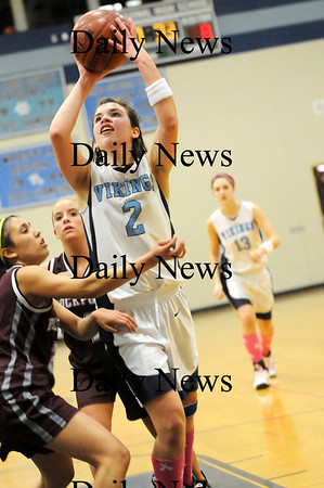Byfield: Triton's Lauren Mihalchik (2) puts up a shot against the Rockport defense during Tuesday night's game in Byfield. Photo by Ben Laing/Staff Photo