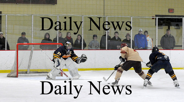 Newburyport: Newburyport's Cameron Roy (4) walks in on Lynnfield's goalie, Craig Cataldo (29), on a short-handed breakaway during Monday's game. Roy would beat Cataldo for the Clipper's third and final goal over their shutout victory over the Pioneers. Photo by Ben Laing/Staff Photo