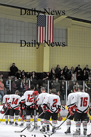 Newburyport: The Amesbury High hockey team stands at attention during the national anthem at Wednesday nights game against Newburyport at the Graf Rink. Photo by Ben Laing/Staff Photo