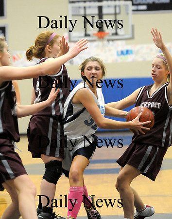 Byfield: Triton's Alison Towns (31) battles through the Rockport defense on her way to the hoop during Tuesday night's game in Byfield. Photo by Ben Laing/Staff Photo