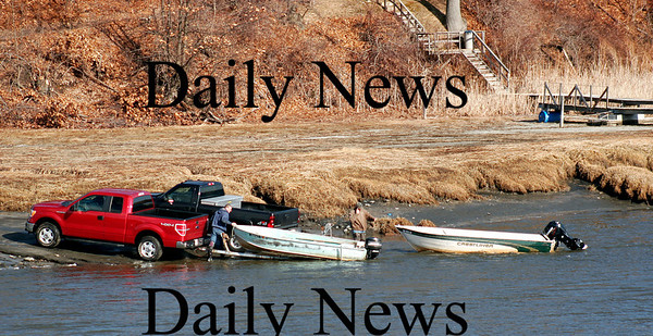 Newbury: A pair of boaters launch their vessels Tuesday afternoon at the boat ramp along the Parker River, taking advantage of the mild weather. Photo by Ben Laing/Staff Photo