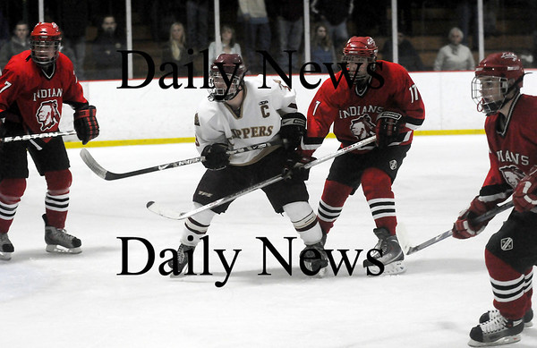 Newburyport: Newburyport's Kyle McElroy (3) is surrounded by a trio of Amesbury defenders during Wednesday's 5-0 win over the Indians. Photo by Ben Laing/Staff Photo