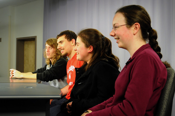 """Amesbury: Answering test questions during a reahearal for the """"High School Quiz Bowl"""" are Amesbury High students from left, Peter Siess, James Pelkey, Lauren Joyce and Samantha Fortin with Tyler Lay and Patrick Hopkins out of view. Bryan Eaton/Staff Photo"""